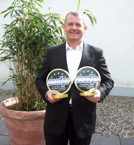 Graham Moore Director, Business Development, Ricoh Europe with the two EDP Awards